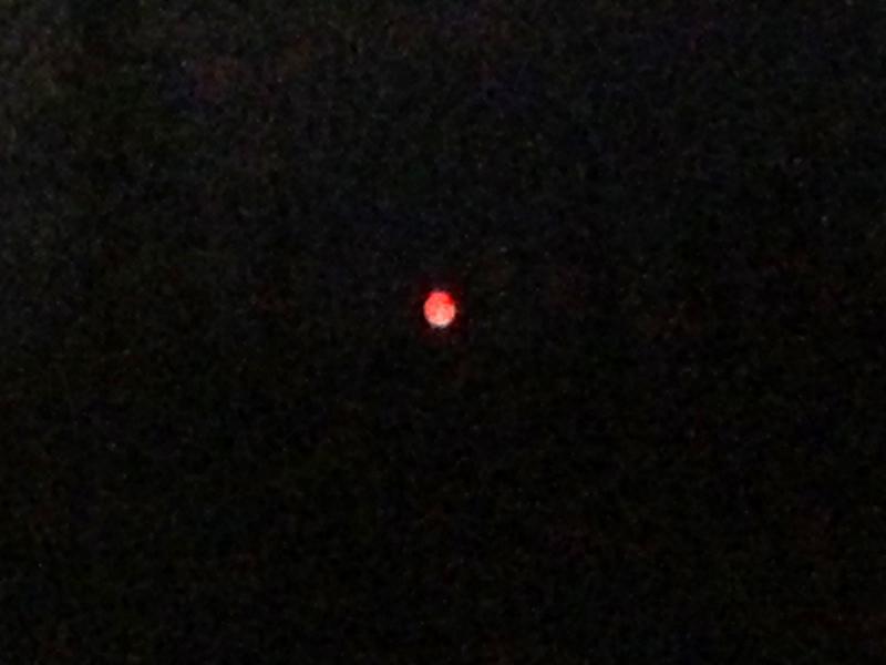 Peephole or moon shrouded in fire smoke